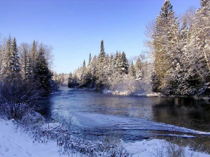 Wisconsin State River in Winter with Snow Fall - Ice Fishing Digest